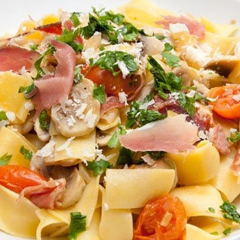 Paccheri with fresh mushrooms, bacon and cherry tonatoes