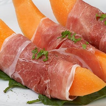 Raw ham and melon